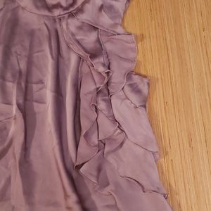 Kenar Tops - Purple sleeveless shirt with ruffles on the front.